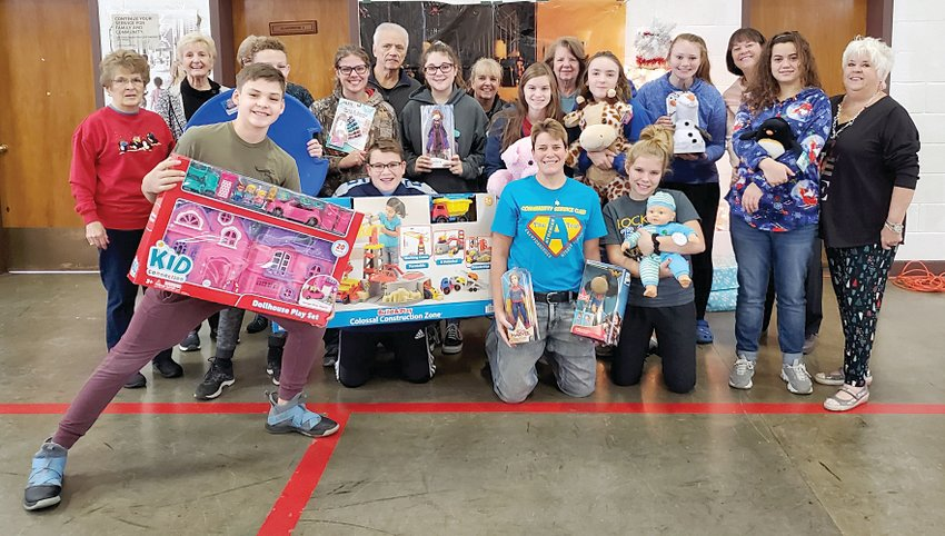 Nothing to do on a winter Sunday afternoon? That was not the case for several middle school students. Members of Crawfordsville Middle School's A-Team helped members of the Deta Theta Tau sorority sort, organize and display more than 20 tables of toys for this year's annual Operation: Toy Box at the National Guard Armory. This was the 26th year for the local event. The A-Team is a group of seventh and eighth grade students who represent high standards in character, leadership, academics, service and attitude. The goal of the organization is to provide students with opportunities to become civically engaged community members while participating in fun service activities. Sponsors Shannon Hudson and Laurie Vellner rewarded the group's hard work with a trip to Culver's for some rest and refreshments.