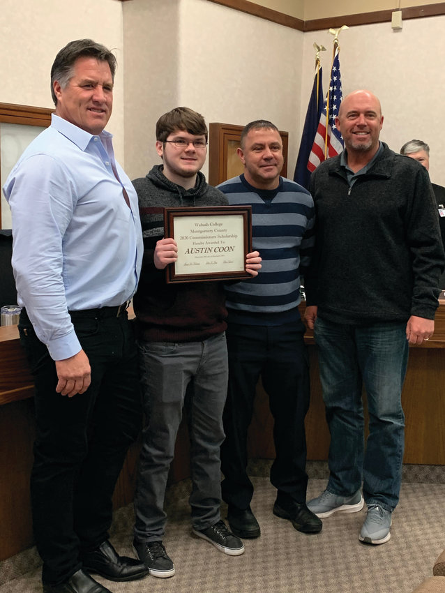 Southmont High School student Austin Coon, second from left, is presented with the Wabash College/Montgomery County 2020 Commissioners Scholarship by commissioners John Frey, Jim Fulwider and Dan Guard Friday at the courthouse.