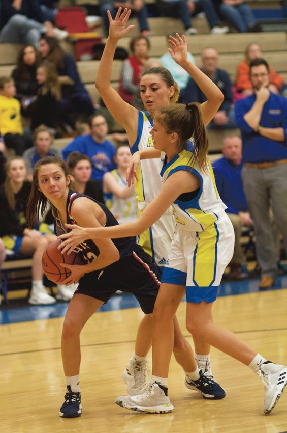 North Montgomery's Maddie Moseley fights for position against Crawfordsville. She led the Chargers with 16 points in their 52-44 win over the Athenians.