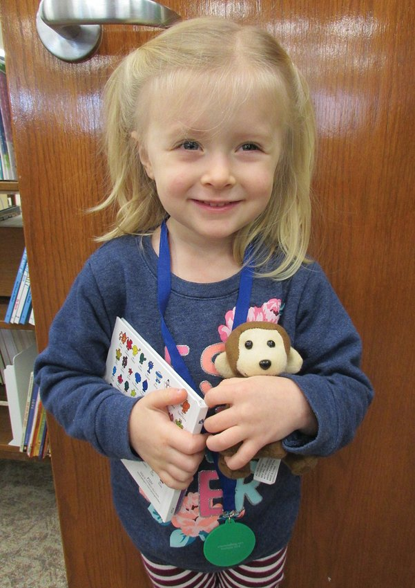 """Sadie Raley, 3, completed the Crawfordsville District Public Library program 1,000 Books Before Kindergarten. She is the daughter of Kyle and Michelle Raley. Sadie's favorite book is """"Who Says Woof?"""" by John Butler. Mom said, """"We are so thankful for our library and this program. Sadie worked so hard to complete her 1,000 books. She asked family members to read to her and even tried to """"read"""" herself."""""""
