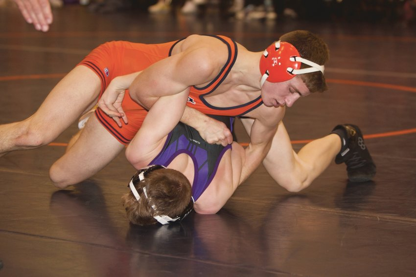 North Montgomery's Baydin Hall works for a pin against Leo.