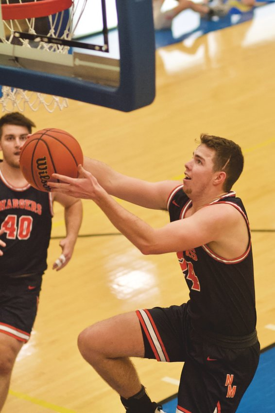 North Montgomery's Alex Wallace goes in for an easy lay-up against Southmont. The senior was named to the all-tournament team.