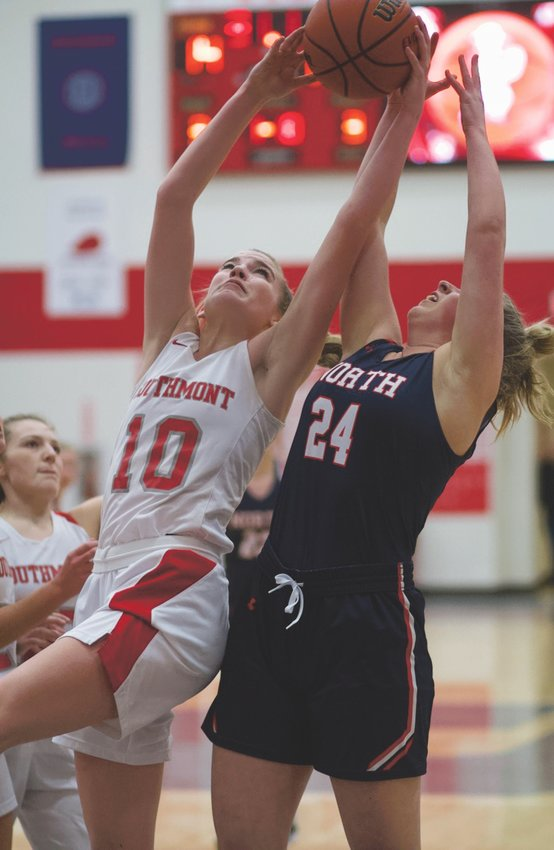 Southmont's Sidney Veatch skies for a rebound over North Montgomery's Sidney Zachary.
