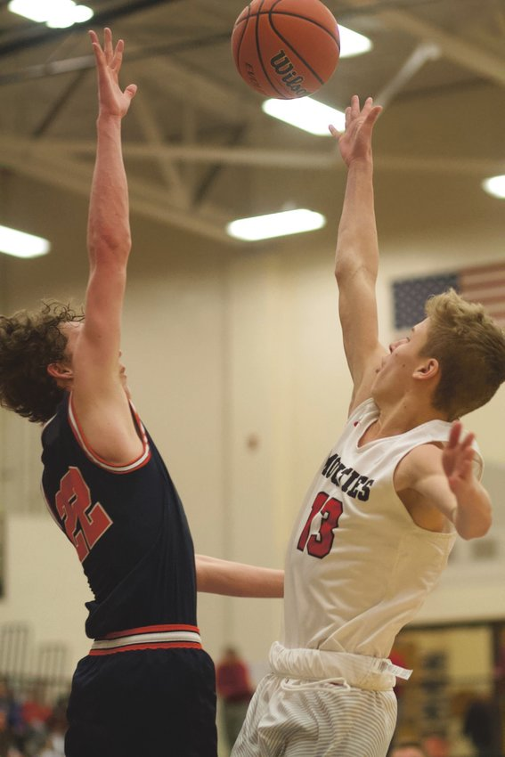 North Montgomery's Preston Shaw attempts to block a shot of Southmont's Cale Hess in a Charger win last Saturday.