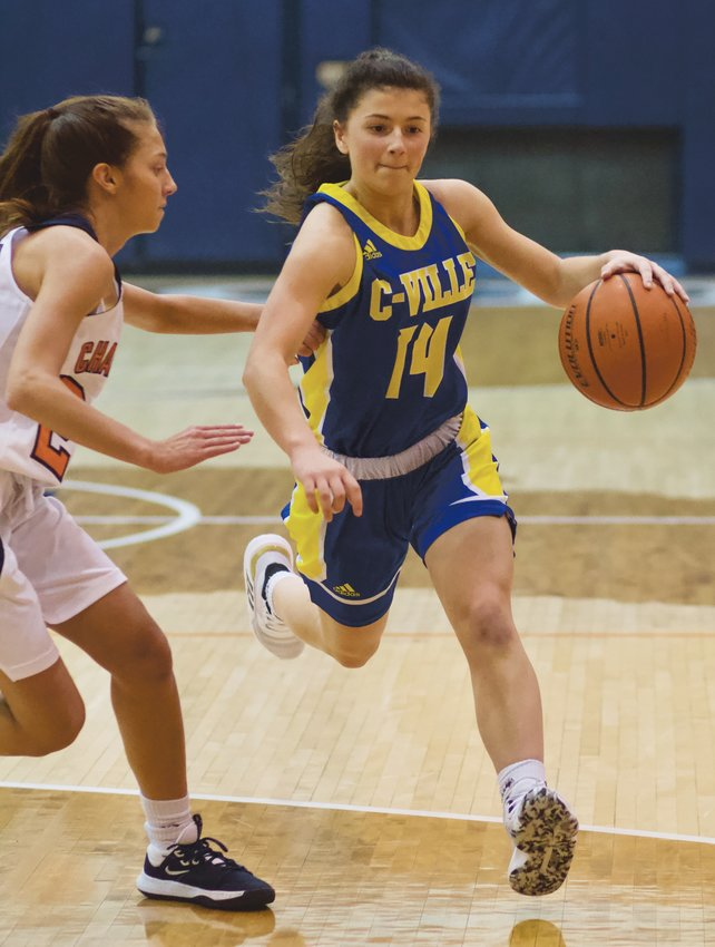Crawfordsville's Shea Williamson drives past North Montgomery's Maddie Moseley in a game earlier this season. The Athenians will play Danville in the sectional, while the Chargers will open with Frankfort.