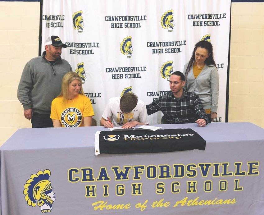 Crawfordsville senior Tristan Bronaugh has committed to continue his track and field career at Manchester University. PICTURED L-R: Tristan's Step-Dad, Mike Inskeep, Mom, Kathleen Inskeep, Tristan, Dad, Jason Bronaugh, and Step-Mom Jennifer Bronaugh