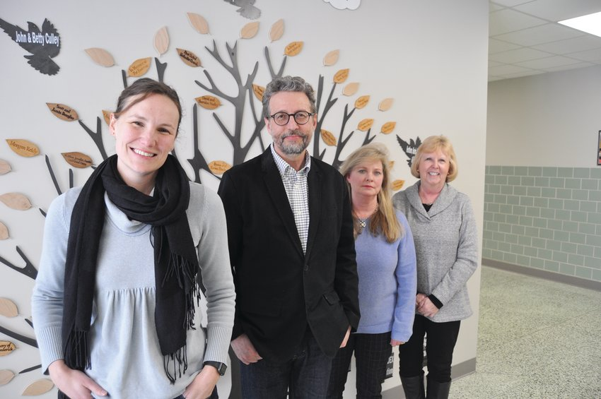 Court-appointed special advocates Kelly Nelson, from left, Michael Abbott, Kristie Ross and Sheila Sowers represent children in the child welfare system. Another group of volunteers will be trained beginning later this month.