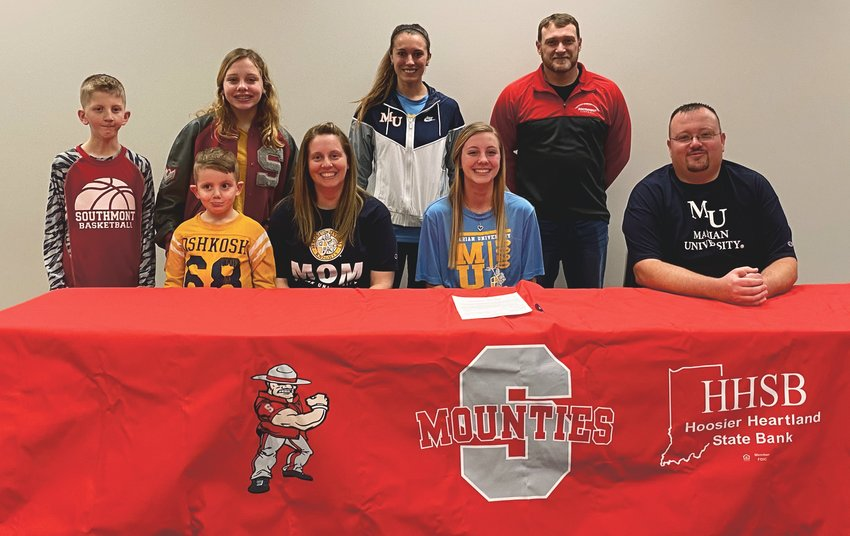 Southmont senior Lexie Odum committed to continue her track and field career at Marian University on Monday afternoon. PICTURED ABOVE: Lexie with her parents Dee and Philip Odum, brothers Finn and Gunner, and sister Lillie. Southmont track and field coach Desson Hannum, and Marian sprint coach Katie Wise.