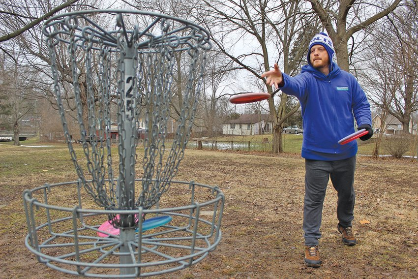 Parks and Recreation personal trainer Jerimiah Adams, 34, takes advantage of a near-empty Milligan Park on Monday to hone up on his disc golf skills. Adams regularly participates in year-round disc golf tournaments, including the ongoing Wintry Indiana Frozen Fundraiser series and the Professional Disc Golf Association.