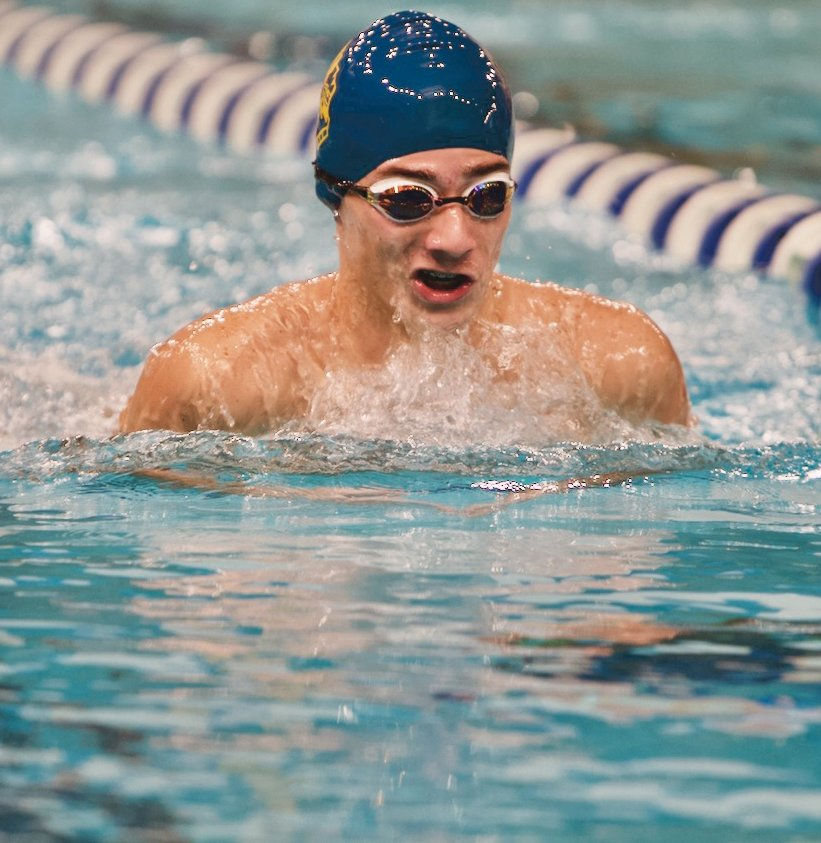 Hunter Conrad competes in the breaststroke for the Athenians.