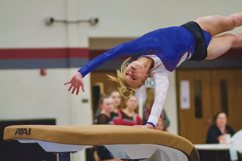 Crawfordsville's Abbie Lain helped lead the Athenians to the county gymnastics title on Monday night. The freshman won the all-around, and recorded a score of 8.75 on the vault.