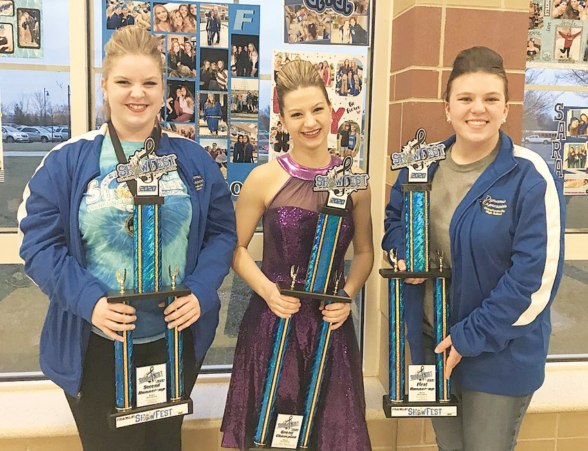 Crawfordsville's Dynamic Expression show choir recently participated in the Franklin Community Showfest 2020. During the solo competition, Crawfordsville High School had 13 soloists who competed. Out of 58 soloists from three states, Crawfordsville swept the top three spots. Pictured from left are Gracie Leonard, second runner-up; Reagan Minnette, grand champion; and Annie Wilson, first runner-up.