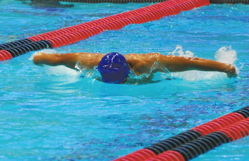 Crawfordsville sophomore Thristan Callejas competes in the 100 butterfly at the Indiana University Natatorium on Friday night.