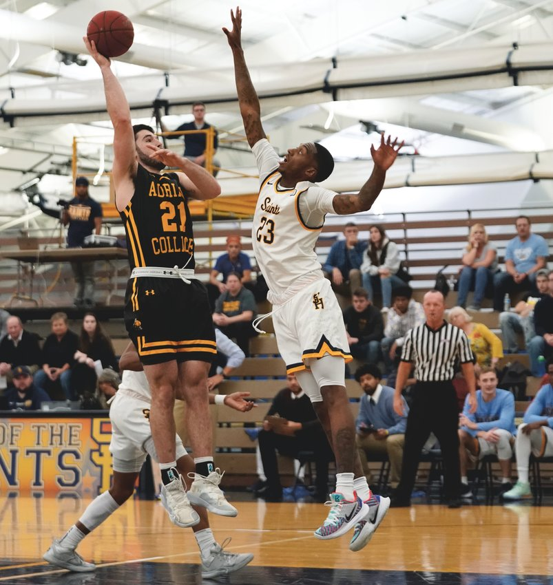 Southmont grad Kaleb Swick fires up a shot in a game earlier this season for Adrian College.