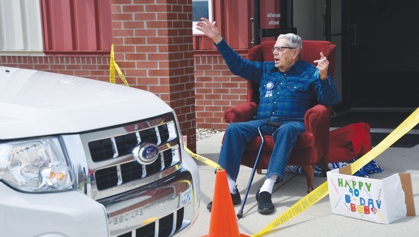 Bob Wheeler of Browns Valley shared Sunday afternoon with a drive-through parade of well wishers for his 90th birthday celebration. Wheeler, known by locals as the self-appointed Mayor of Browns Valley, retired from RR Donnelly after more than 41 years. He retired from the Indiana Army National Guard as the CSM from Crawfordsville 139th Field Artillery 3rd Battalion Crawfordsville, after serving proudly for more than 30 years of service. Wheeler and his late wife Maxine were the parents of six children. In the bottom right photo, David Lawler of Crawfordsville and a retired member of the 3rd Battalion 139th Field Artillery, Indiana Army National Guard, shares a special memory with Bob during the drive by celebration. Sunday's celebration was a refreshing break from the stay-at-home order. Many residents said they had not been out of the house since mid-March. Birthday cards can be sent to Wheeler at 9543 S. C.R. 475W, Waveland, IN 47989.