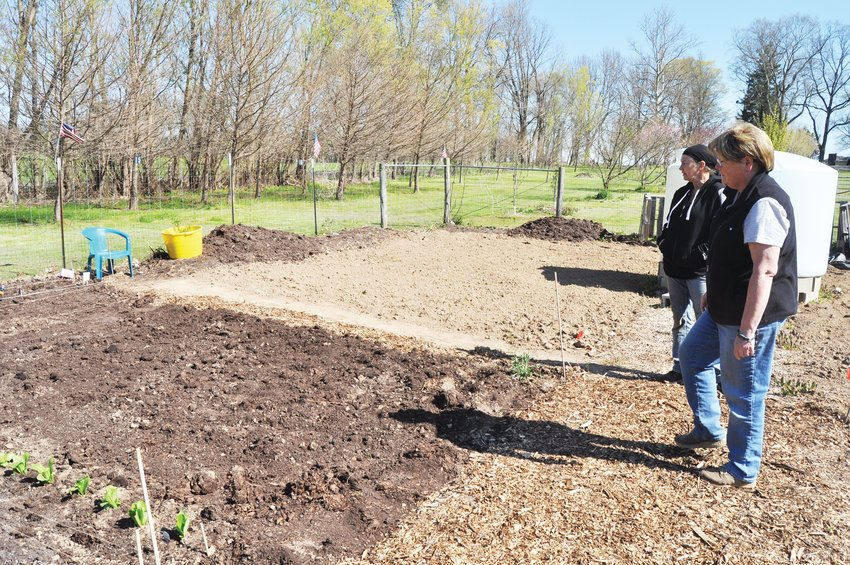 Sue Lucas, left, president of Sustainable Initiatives of Montgomery County, and Susan Smith, co-host of the Crawfordsville Community Garden, look at a freshly-planted plot.