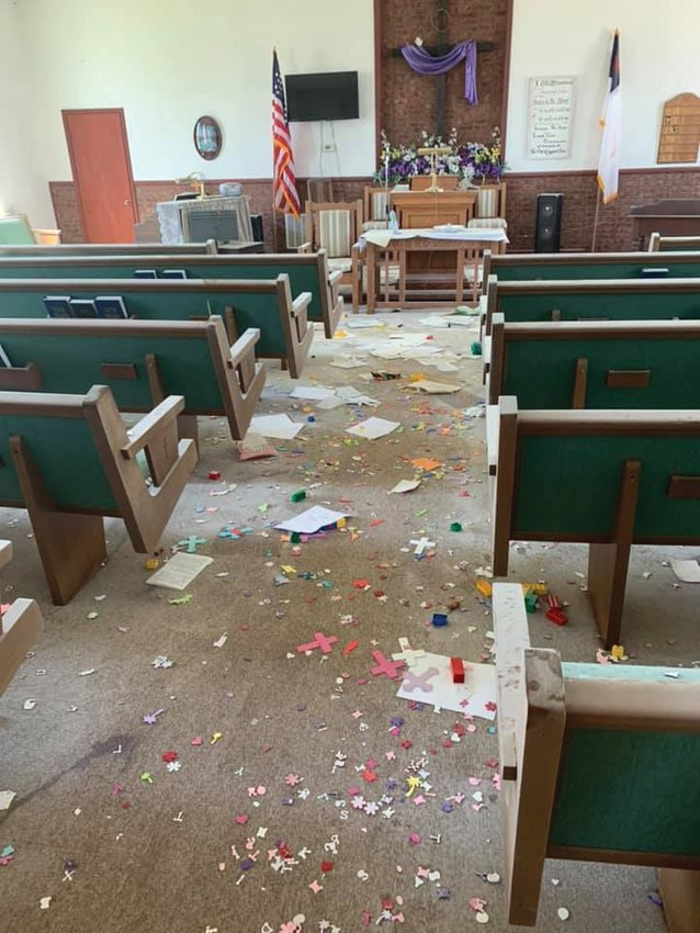 Craft supplies and paper lie strewn across the floor in the sanctuary of Byron Christian Church. Multiple rooms of the church were struck by vandals last week, and two children have been arrested in the case.