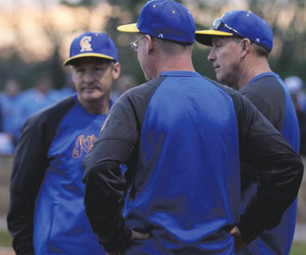 Coach Froedge chats with his assistants, Rhett Welliever and Tony Bean.
