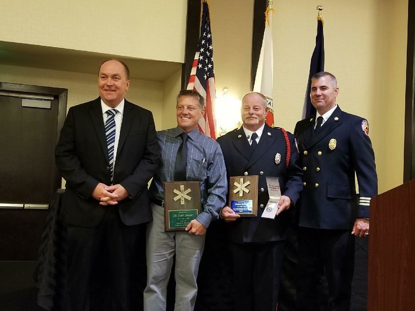 Pictured, from left, is Crawfordsville Mayor Todd Barton, Dr. Scott Sinnott with the Franciscan Physician Network, Darren Forman and Crawfordsville Fire Department Division Chief of EMS Paul Miller. The photo was taken when Forman was named 2019 Paramedic Hero of the Year by the Indiana Department of Homeland Security and Indiana Fire Chief's Association.