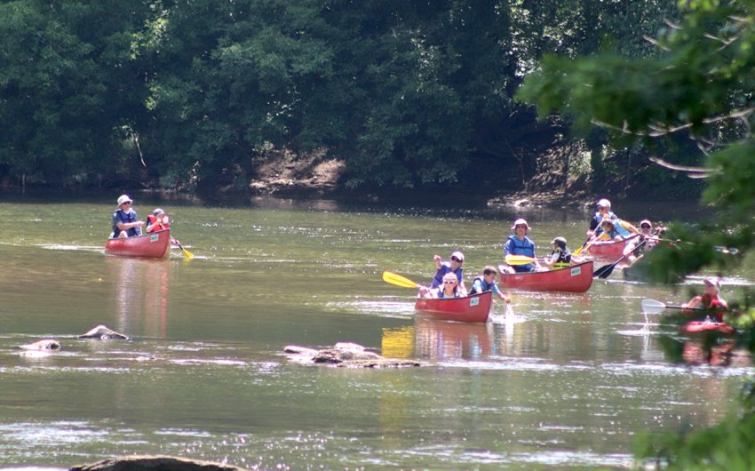 """Taking part in the Friend of Sugar Creek """"Kids Canoes and Crinoids"""" canoe trip down Sugar Creek on Saturday, several participants and their leaders make the final push toward Rock River Ridge Trailhead after stopping along the way to observe fossils and learn about nature."""