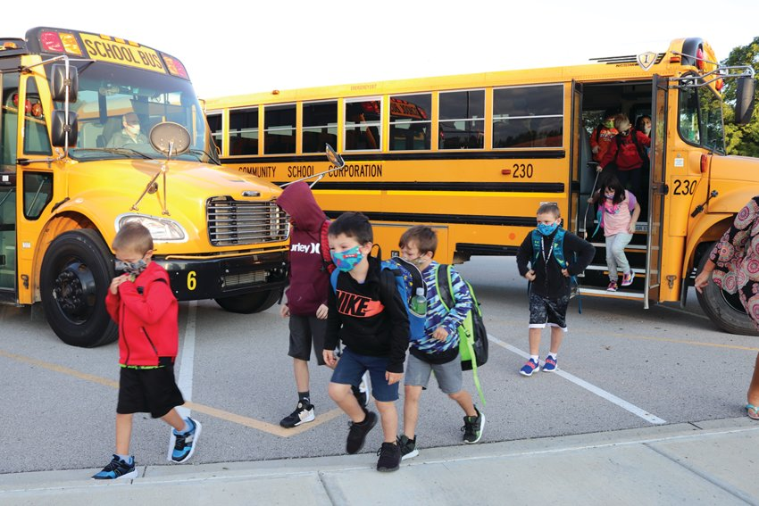 New Market Elementary students, anxious to begin their first day of school Thursday, head toward the entrance from buses that were visibly half full to promote social distancing during the ongoing coronavirus (COVID-19) pandemic.