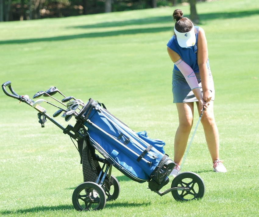 Crawfordsville's Bailey Mittal chips an approach show to the green at the Crawfordsville Country Club on Saturday afternoon. The senior led the Athenians with a personal best score of 89.