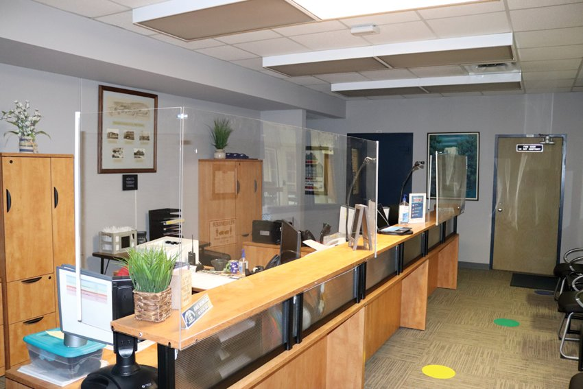 The central office at Fountain Central Jr.-Sr. High School now has plexiglass partitions and barriers lining the counters.