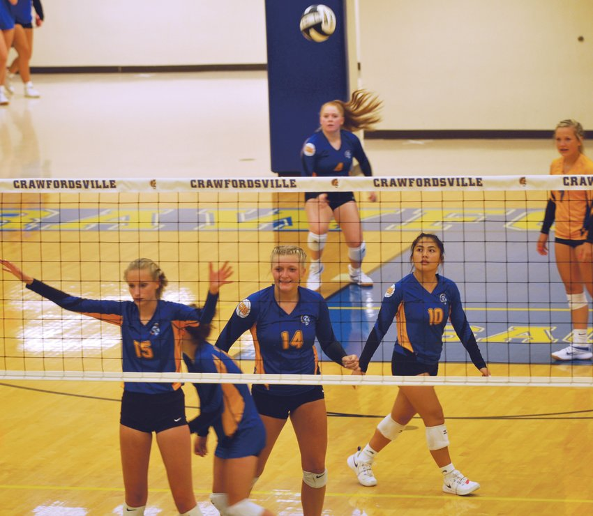 Crawfordsville's Laine Schlicher served 13 straight winners for the Athenians as they rattled off 13 straight points in the first game against Sheridan during a 3-0 win on Monday night.