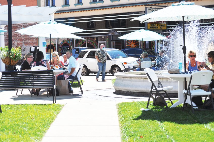 People have lunch while listening to folk artist Sharon McKnight during Crawfordsville Main Street's Lunch on the Plaza 2.0 at Marie Canine Plaza Friday. The series is set to wrap up with accordionist Josie Beach on Sept. 18.