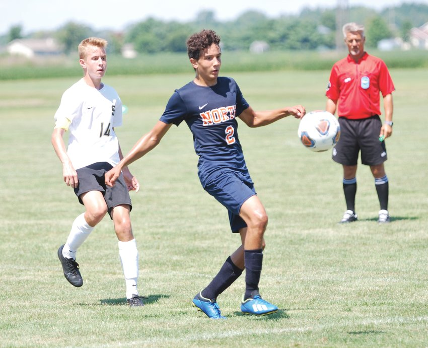 North Montgomery's James McClerkin receives a pass in a match against South Vermillion on Saturday.