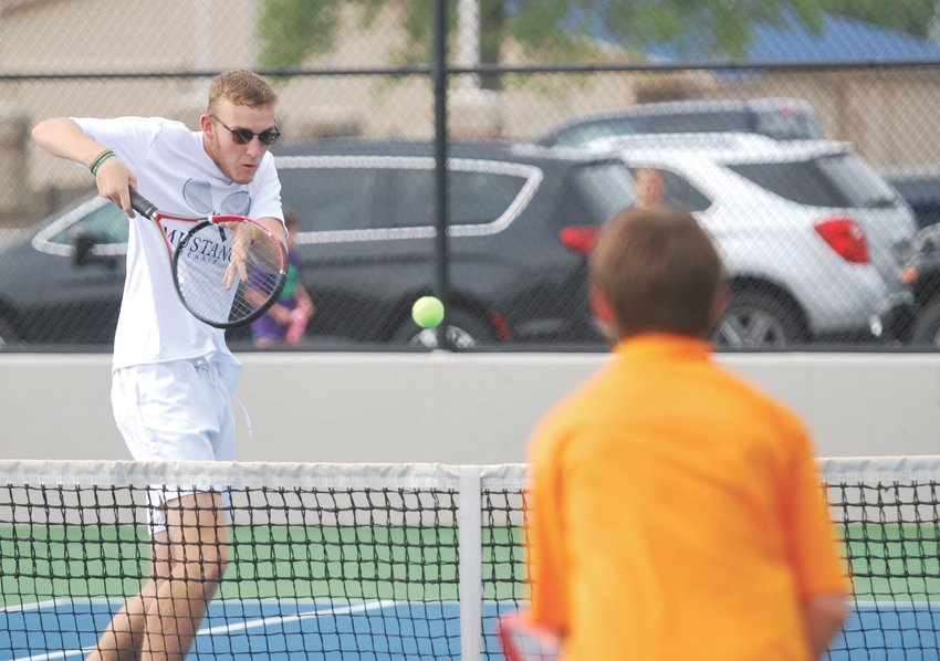 Fountain Central's Jacob Keeling returns a shot at No. 1 doubles against North Montgomery on Monday.