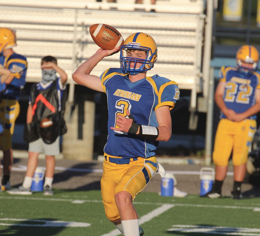 Kaiden Underwood fires a pass in the Athenians' 48-14 loss to Western Boone.