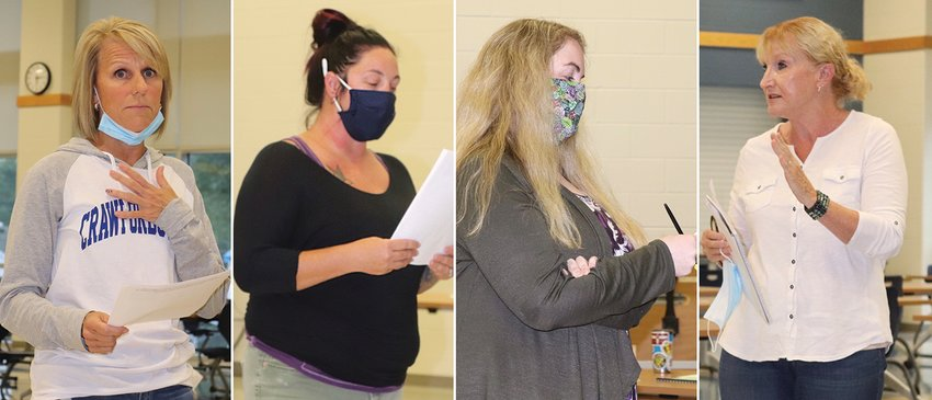 Erica Minnette, from left, Angelina Ball, Emily Race and Sharon Olsen deliver impassioned speeches during Crawfordsville Schools' Thursday night meeting at the middle school.