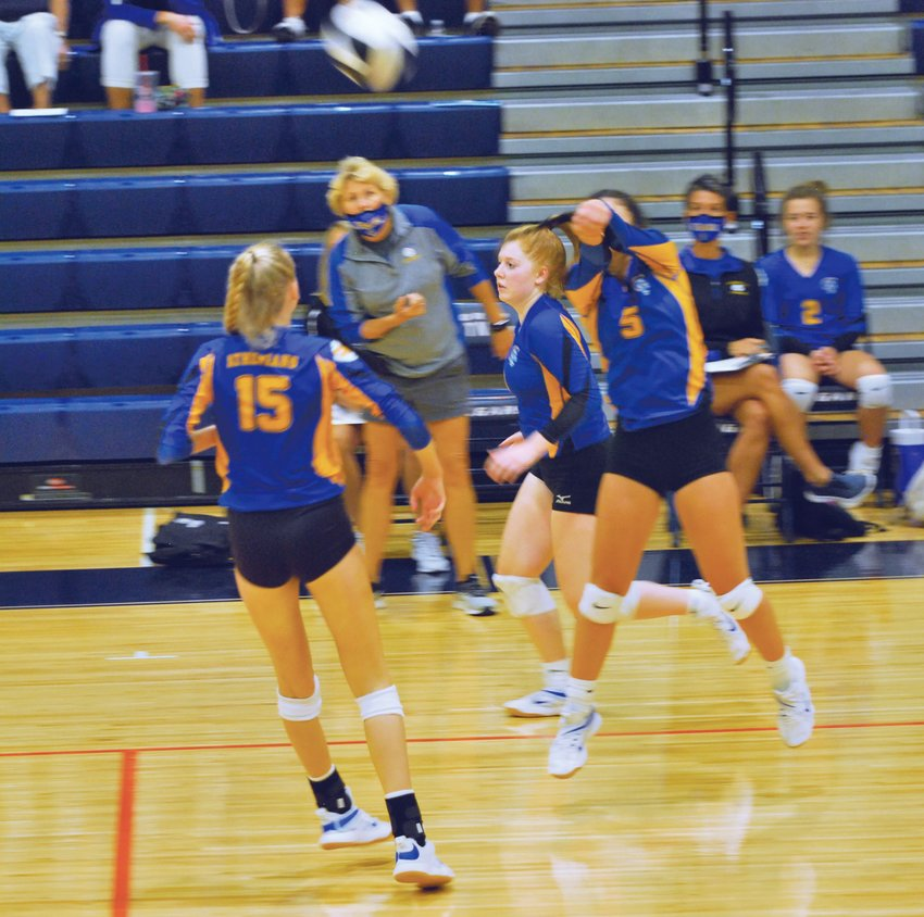 Crawfordsville's Shea Williamson returns a shot against North Putnam on Tuesday. The junior had 26 digs and 15 assists in the Athenians' 3-1 win over North Putnam.