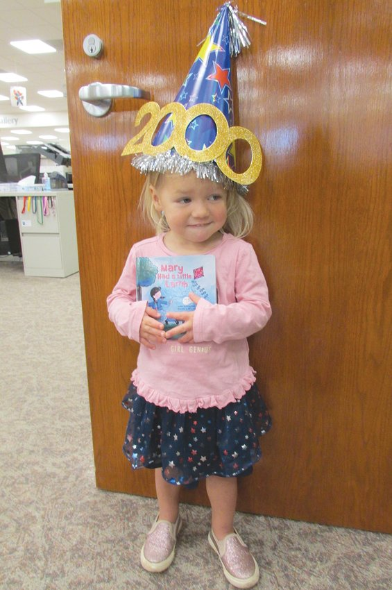 """Julia Nichols, 2, has completed the Crawfordsville District Public Library program, 1,000 Books Before Kindergarten, again for the second time. Along, with her parents, Tyler and Mindy Nichols, they have read 2,000 books. Julia's favorite book is """"Princess Hyacinth (The Surprising Tale of a Girl Who Floated)"""" by Florence Heide. Mom said, """" Miss Janella and Miss Karen have been so wonderful in their modifications to the reading programs. We look forward to our weekly stories, activities and crafts to stay involved with our library friends."""""""