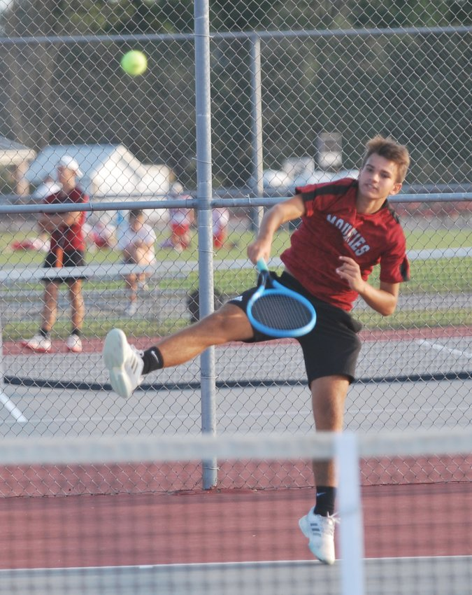 Southmont ace Adam Cox pulled off a straight-set win over Parke Heritages' Evan James at No. 1 singles.