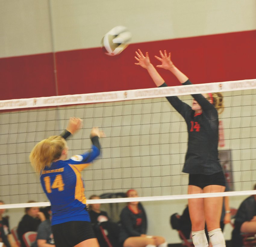 Southmont's Sidney Veatch reaches for the block of Crawfordsville's Macy Bruton.