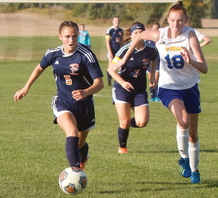 North Montgomery's Teegan Bacon looks to score against Crawfordsville on Thursday. With a hat trick, Bacon now owns the all-time single season goals record for Charger girls' soccer with 22 goals.