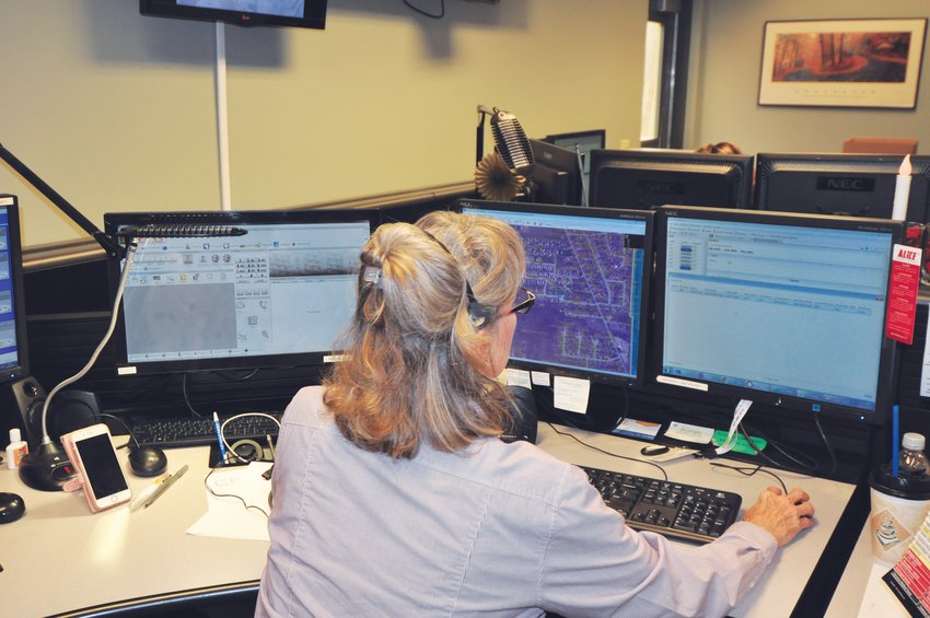 A dispatcher works in the Montgomery County Central Communications Center.