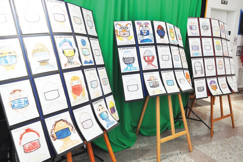 """Pictures of """"MoCo Superheroes"""" drawn by children are displayed at the Carnegie Museum of Montgomery County. The exhibit is on display during regular museum hours of 10 a.m. to 5 p.m. Wednesday through Saturday."""