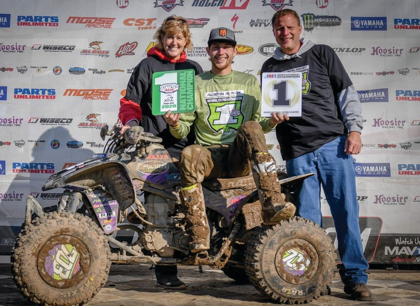 Austin Abney celebrates with his parents, Beth and Darrel Abney after clinching the XC2 Pro-Am championship at the Ironman in October.