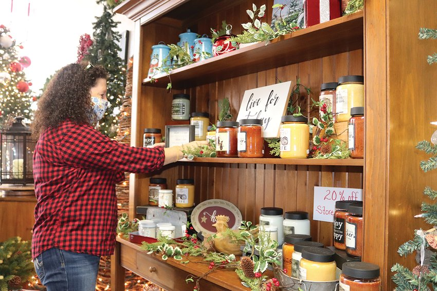 Susie Birdsong, owner of Country Hearts and Flowers on Green Street since 2016, makes some slight adjustments to her holiday displays Friday morning during a two-day open house blitz for flower and gift shops downtown. The event, sponsored by Crawfordsville Main Street, encourages holiday shoppers to buy local and support Crawfordsville small businesses.
