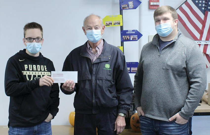 The Parke Heritage High School FFA chapter has received a Way-to-Go grant from the Parke County Community Foundation. Each Foundation board member may select a local organization or group to donate $100. Board member Marvin Rode selected the FFA chapter for his organization. He presented the check to JD Seward, who serves as the chapter Sentinel. The FFA chapter is advised by Colton McMullen and Shannon Witty. Pictured, from left, are Seward, Rode and McMullen.
