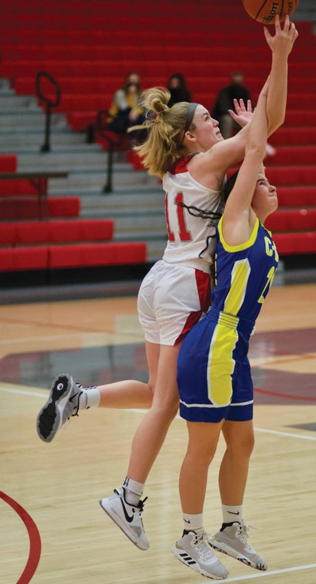 Southmont's Sidney Veatch fights for position in a game earlier this season against Crawfordsville. On Saturday, the senior led the Mounties to a win over Frontier.