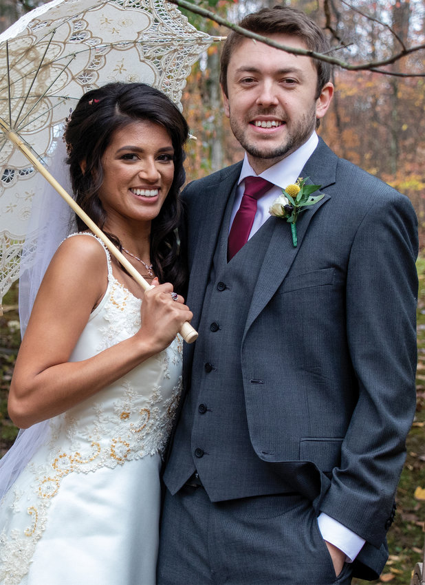 Eric Hook and Cheyonna Navarro exchanged wedding vows Oct. 27.