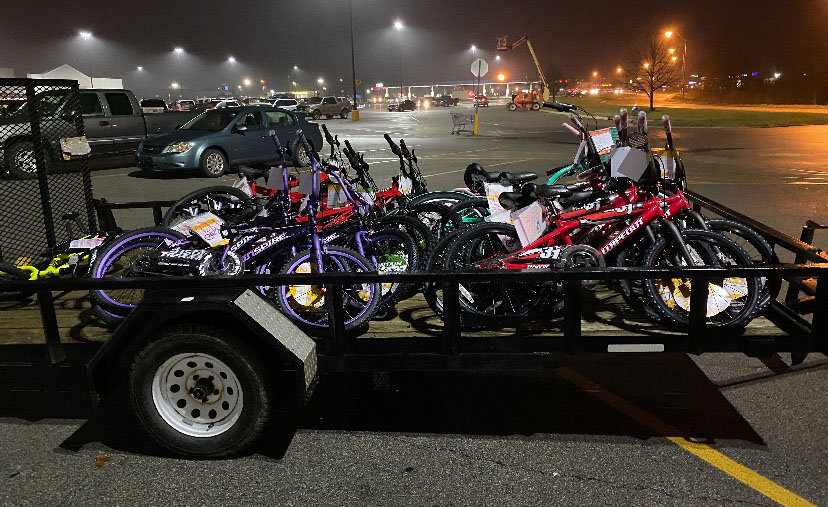 Bicycles to be distributed to local children in need sit on a trailer at Walmart. About 40 bikes were given to Montgomery County children in need in a project coordinated by local resident Steve Baldwin.