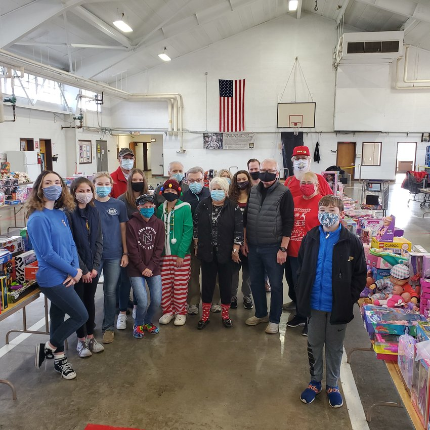 Members of the Crawfordsville Kiwanis and the Crawfordsville Middle School A-Team paired together to help with the annual Operation:   Toybox campaign. Twenty volunteers arrived at the National Guard Armory to sort and shop, ensuring that kids in Montgomery County will have presents under the tree this Christmas.