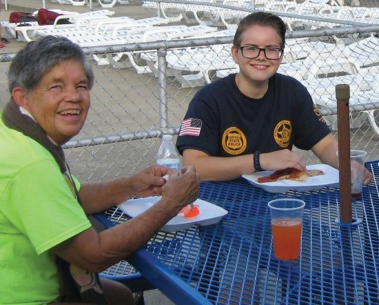 Leah Rusk, right, and her mentor Terry Lawrence enjoy a meal at a JUMP program outing. Rusk has been a program participant since 2012. She is now pursuing a bachelor's degree at Indiana State University and dreams of a law enforcement career.