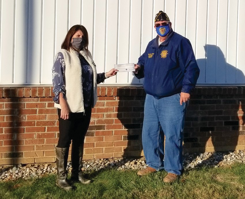 Post 72 Legion Commander Rodney Strong presents a check to a member of the Crawfordsville Sunshine Society in the fall. Strong, named one of the Journal Review's Shining Star award winners, spends much free time volunteering for the Legion and various organizations in Fountain and Montgomery counties.