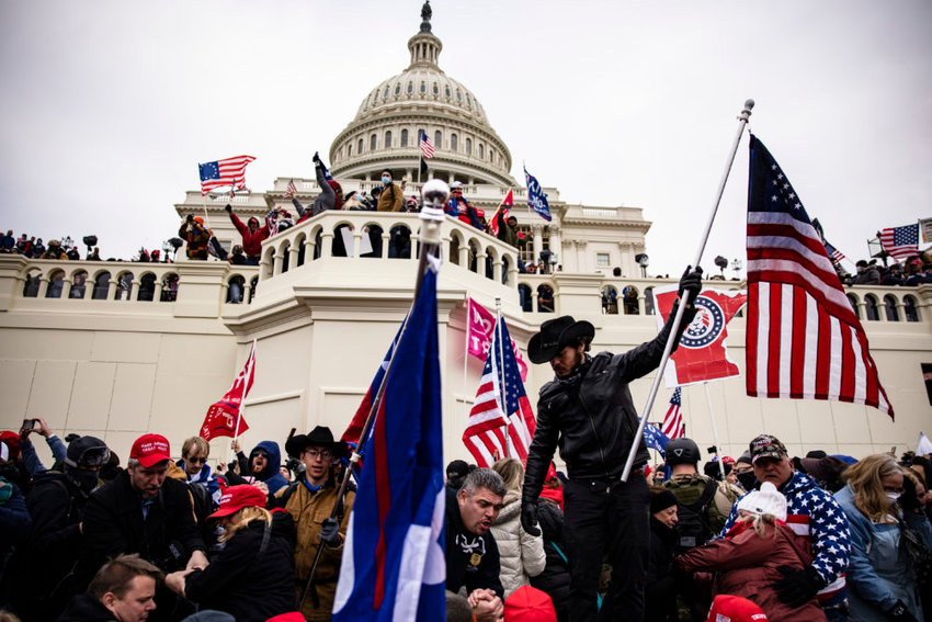 Pro-Trump supporters storm the US Capitol following a rally with President Donald Trump on January 6, 2021 in Washington, DC. Trump supporters gathered in the nation's capital today to protest the ratification of President-elect Joe Biden's Electoral College victory over President Trump in the 2020 election.